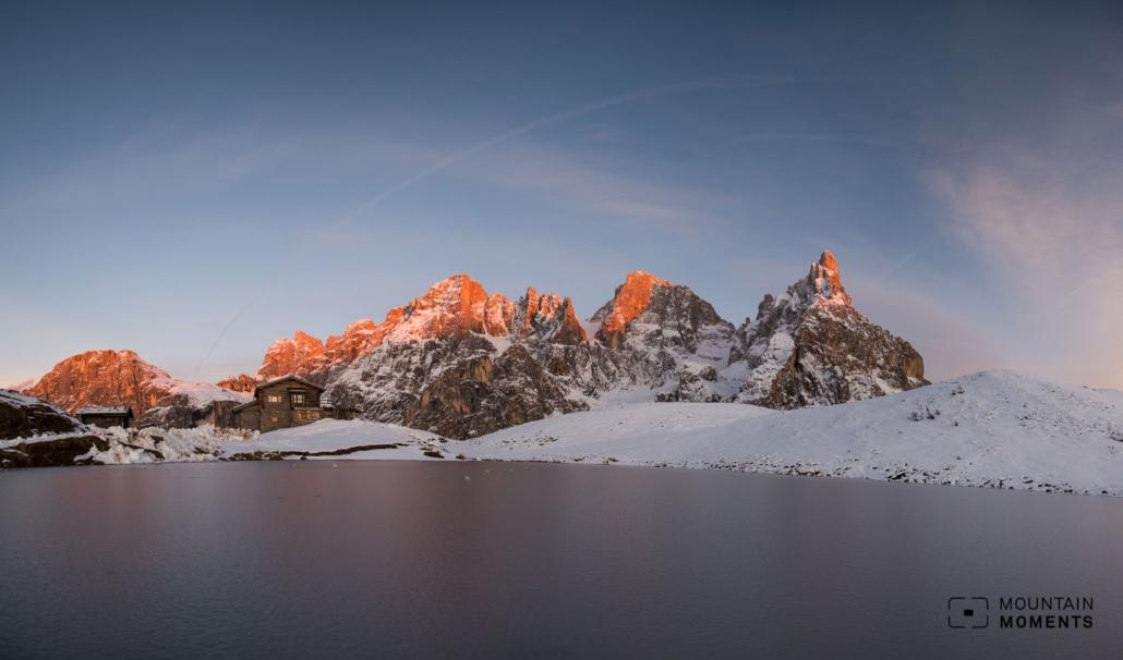 Adored mountain lake in winter time (Baita Segantini).