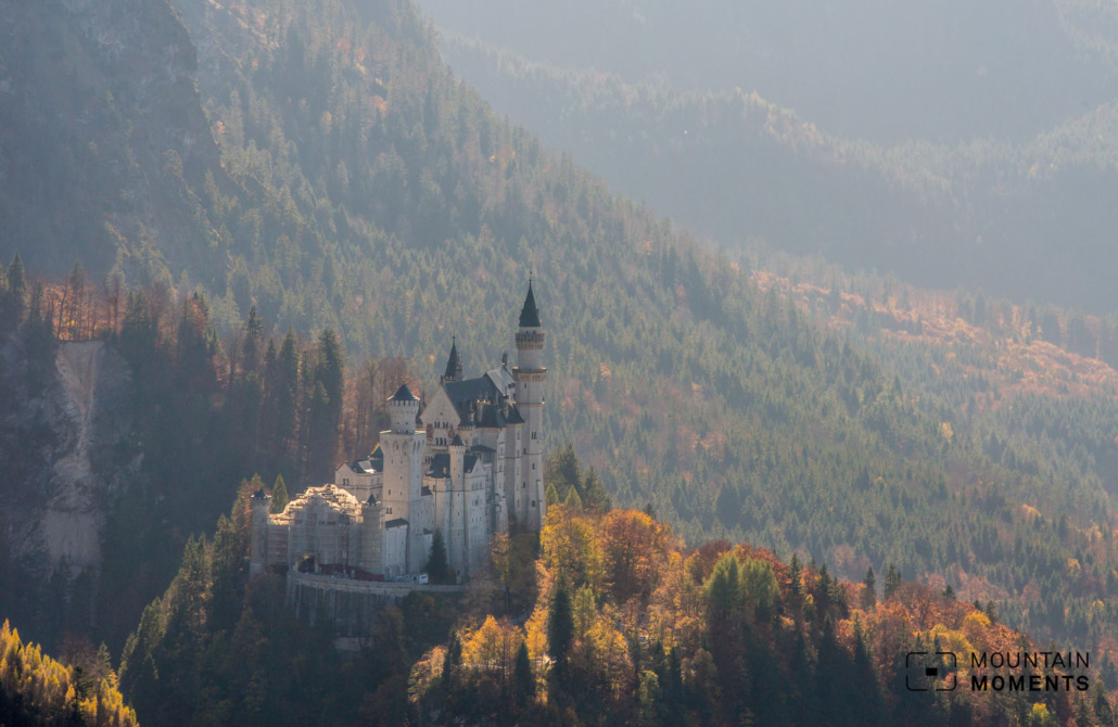 This is probably our favorite place to take great pictures of Neuschwanstein Castle without having to push through the crowds. To take a photo here, drive to the parking lot at the Tegelbergbahn (parking fee 8 euros) and go to the clearly visible cable car valley station.